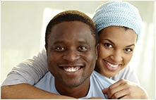 Man and woman with healthy smile after general dentistry