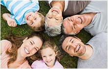 Large family smiling after dental services